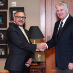 H. E. Ambassador Dr Arjun Kumar Karki shakes hands with the Samaritan's Purse President Franklin Graham during airlift ceremony as 50 tons of winter supplies are heading to Nepal from Charlotte Douglas International Airport, United States. Jan 15, 2016